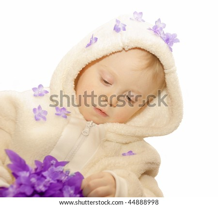 little girl with lilac silk flowers on white background, space for text - stock photo