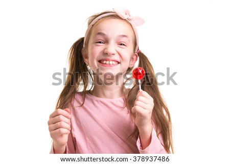 little girl with lollipop smile - stock photo