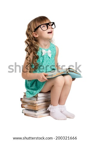 little  girl with long curls, in big optical glass sit on pile of old books holding opened book and  look up isolated on white - stock photo
