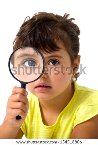 little girl with magnifier isolated on white - stock photo