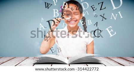 Little girl with magnifying glass against light design shimmering on silver - stock photo