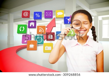 Little girl with magnifying glass against red arrow in white room - stock photo