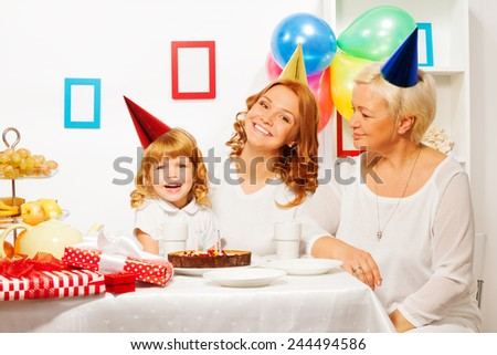 Little girl with mother and granny on birthday