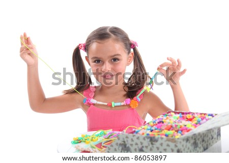 Little girl with necklace - stock photo