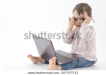 little girl with notebook and glasses - stock photo