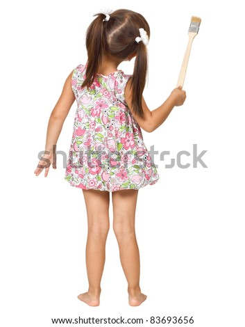 little girl with paintbrush, back view - stock photo