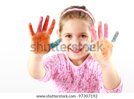 Little girl with painted hands on white background - stock photo