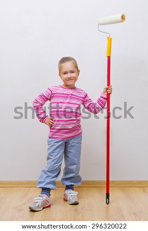 Little girl with painting roller - stock photo