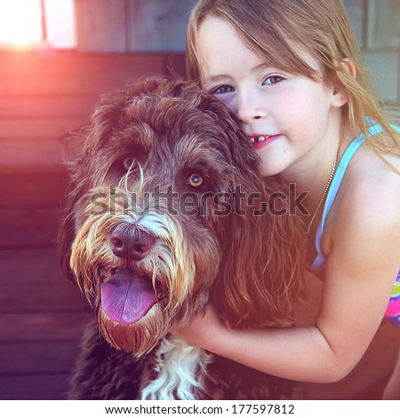 Little Girl with pet dog closeup - instagram effect