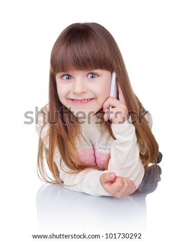 Little girl with phone on light background - stock photo