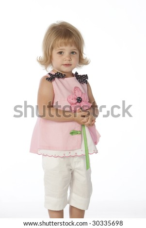 Little girl with pink flower dress hands folded - stock photo