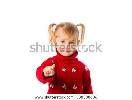 Little girl with ponytails in a warm red sweater isolated on a white background. - stock photo