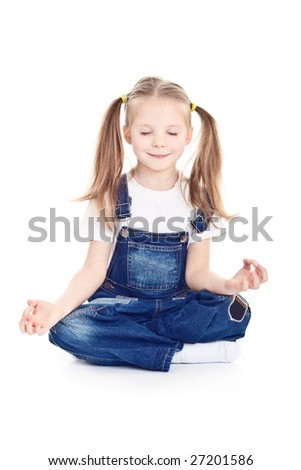 Little girl with ponytails sitting calmly on the floor - stock photo