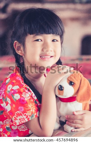 Little girl with puppy toy