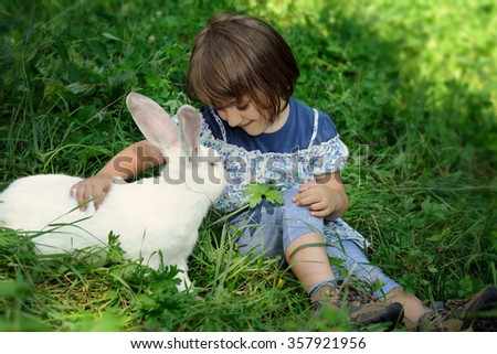 little girl with rabbit - stock photo