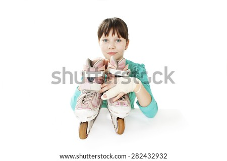 Little girl with roller skates and broken hand. Isolated on white background  - stock photo