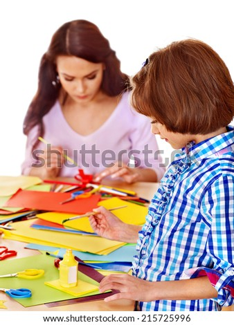 Little girl with  scissor  at school. Education. - stock photo