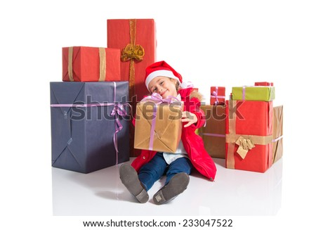 Little girl with several presents - stock photo