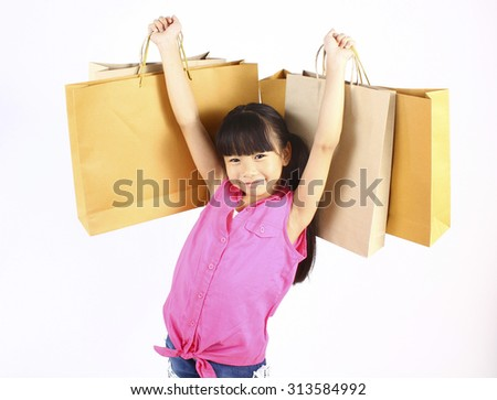 Little girl with shopping bags - stock photo