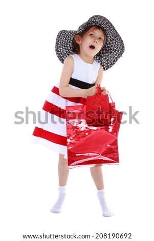 little girl with shopping bags and packages.kindergarten, the concept of childhood and joy, teens - stock photo