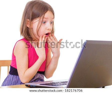 Little girl with silver color laptop on the ground isolated on white - stock photo