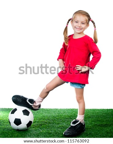 little girl with soccer ball in boots on a green lawn over white - stock photo