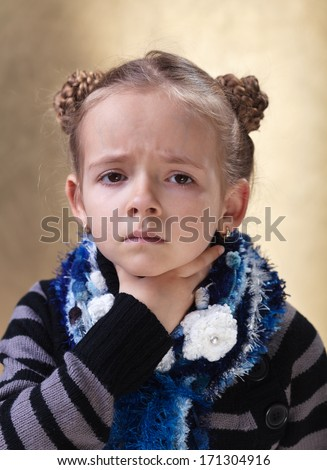 Little girl with sore throat looking sad - stock photo