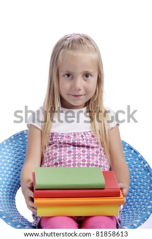 little girl with stack of books. isolated on white background - stock photo