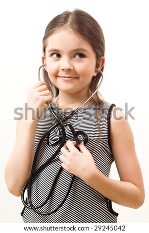 Little girl with stethoscope - stock photo
