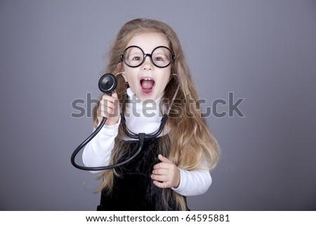 Little girl with  stethoscope. Studio shot. - stock photo