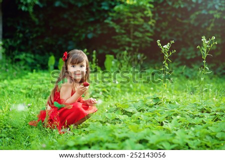 Little girl with strawberry - stock photo