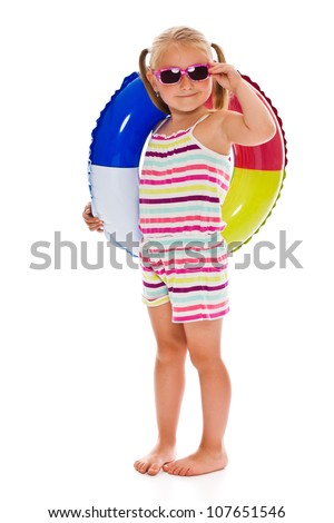 little girl with sunglasses and inflatable ring on white background