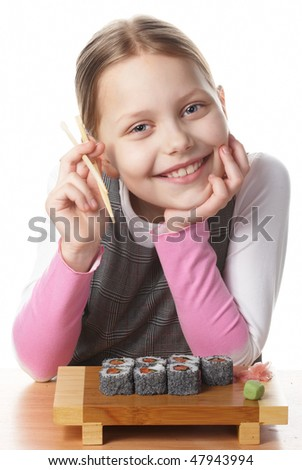 Little girl with sushi - stock photo