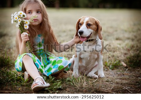 little girl with the dog outdoors - stock photo