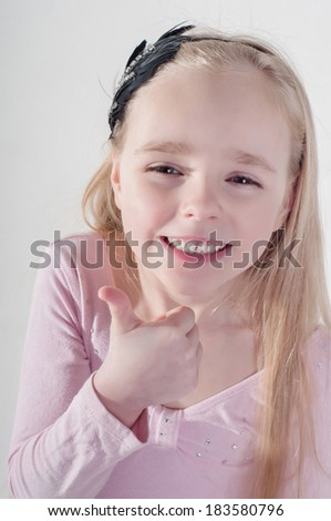 Little girl with thumb up - stock photo