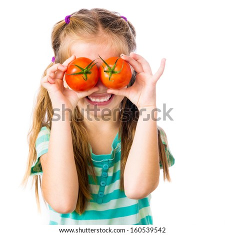 little girl with tomatoes near the eye on a white background - stock photo