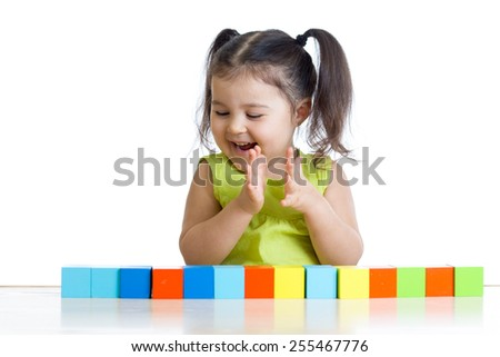 Little girl with toy blocks, isolated on white