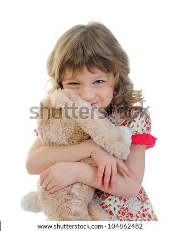 Little girl with toy hare. isolated on a white background - stock photo