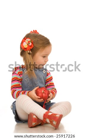 little girl with toy on a white background