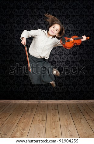 little girl with violin jumping - stock photo