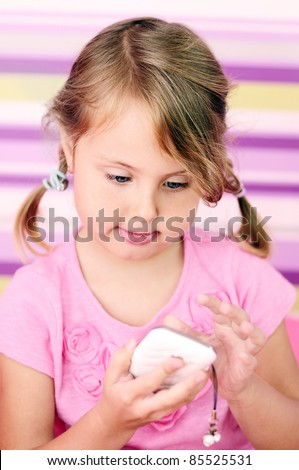 little girl with white smartphone - stock photo