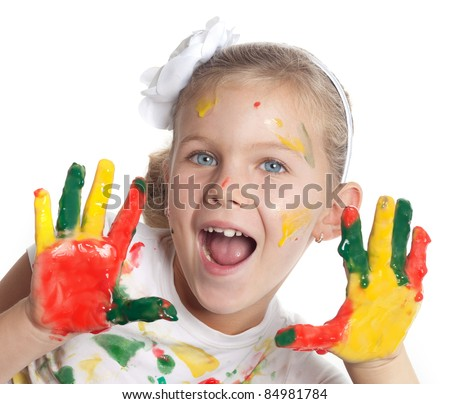 little girl with with hand painted in colorful paints