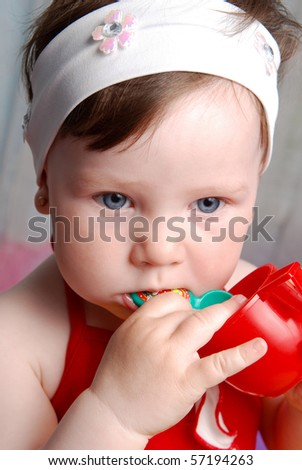 Little girl with with red cup