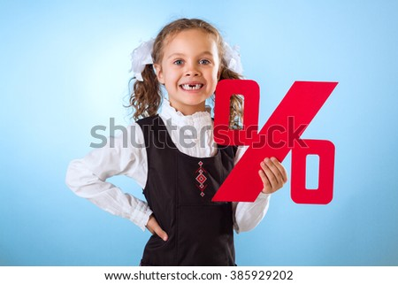 Little Girl Without Teeth Holding A Percent Sign Isolated On Blue Background - stock photo