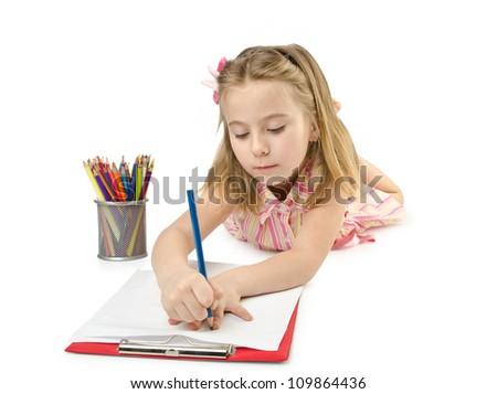 Little girl writing on white - stock photo