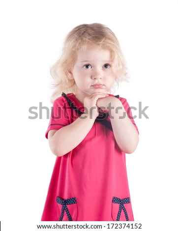 little girl 3 years old in a red dress isolated on white background