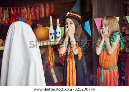 Little girls afraid of the ghost - stock photo