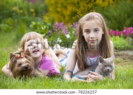 little girls and  cat and dog