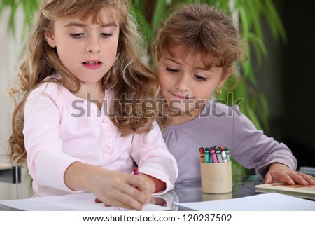 little girls drawing - stock photo