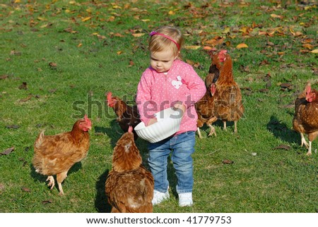 Little Girls feeding the chickens